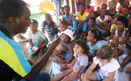 Nal'ibali Literacy Mentor reading to children